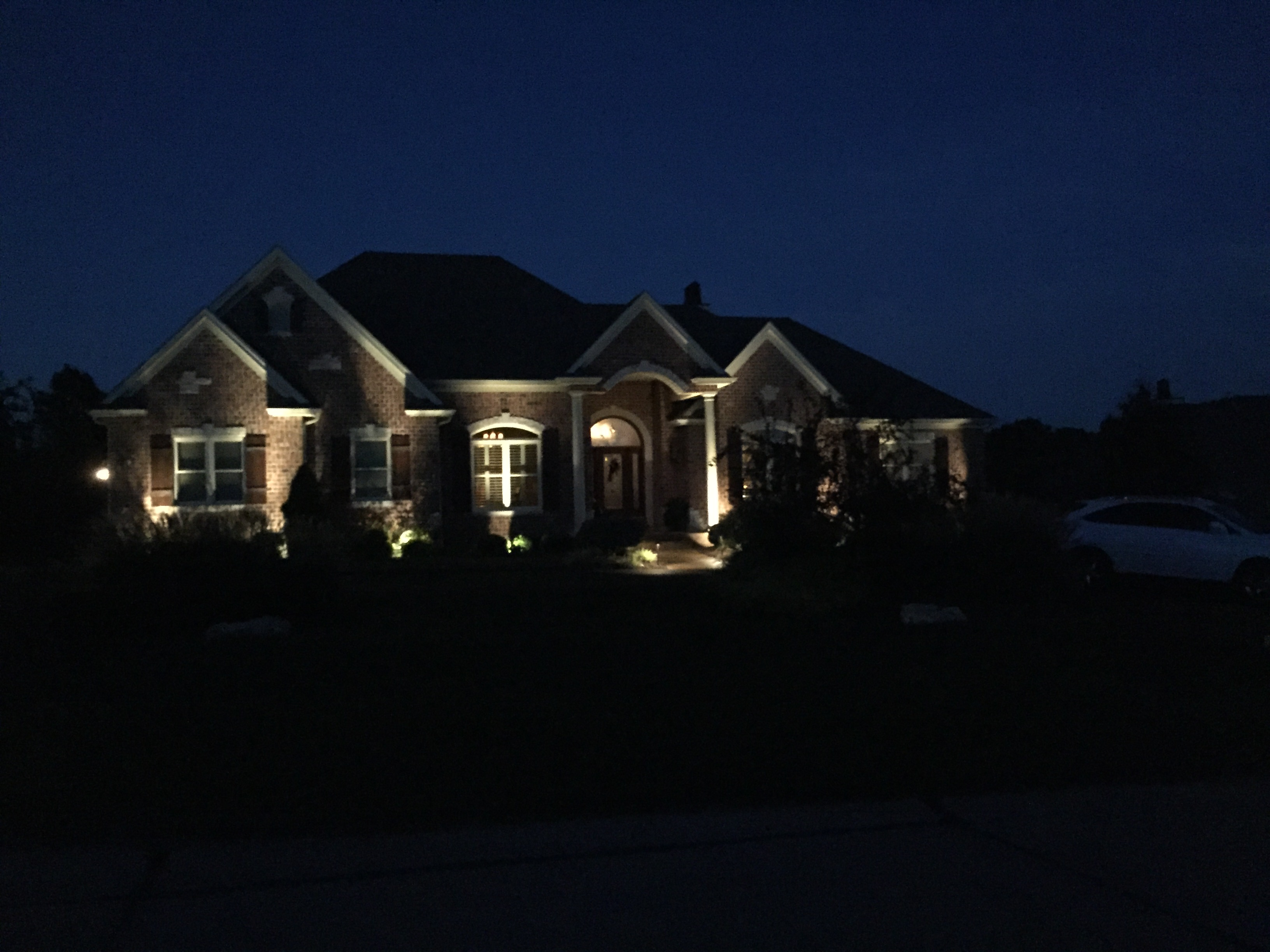 House at Night with Exterior Lighting