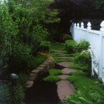 Decorative Walkway with a White Fence