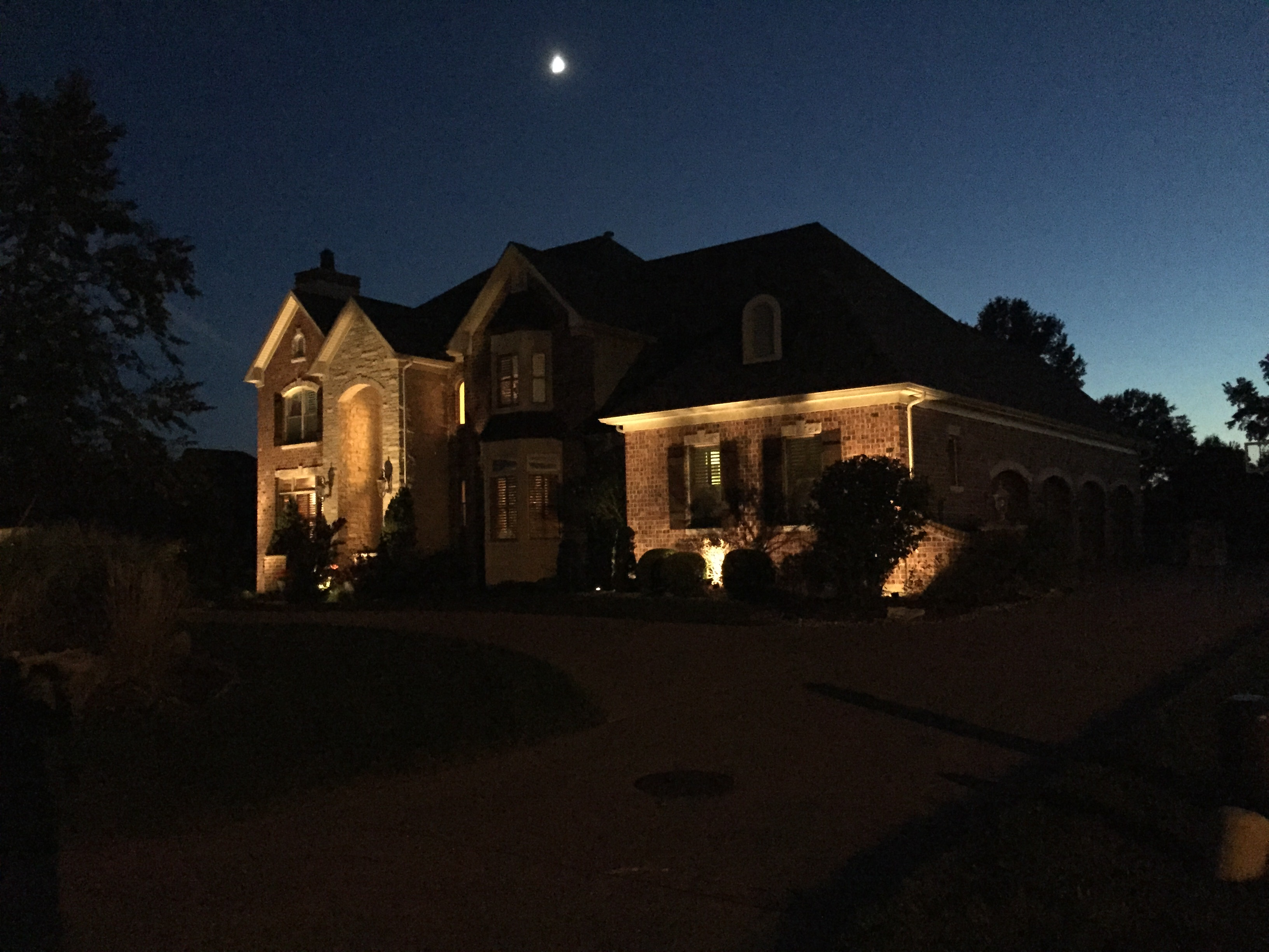 House with Exterior Lighting and Driveway
